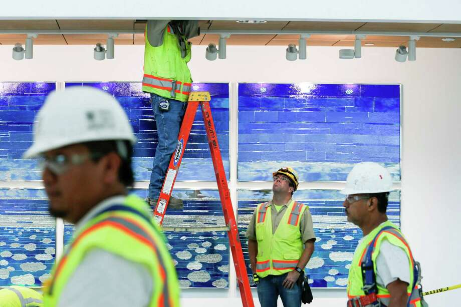 Workers were busy on Monday constructing a concourse for Hobby Airport that will include five additional gates. Photo: Eric Kayne / Eric Kayne