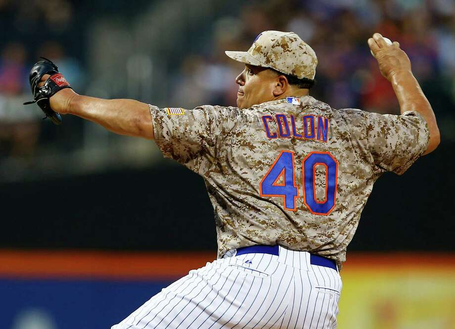 NEW YORK, NY - AUGUST 31: Pitcher Bartolo Colon #40 of the New York Mets delivers a pitch against the Philadelphia Phillies during the first inning on August 31, 2015 at Citi Field in the Flushing neighborhood of the Queens borough of New York City. (Photo by Rich Schultz/Getty Images) ORG XMIT: 538593709 Photo: Rich Schultz / 2015 Getty Images