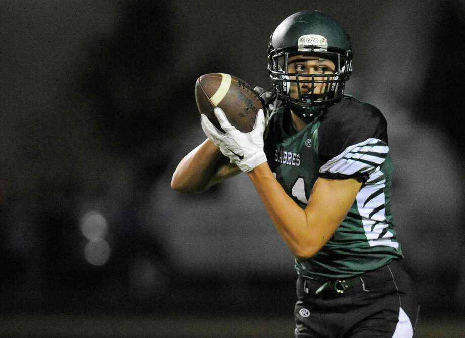 Schalmont's Zac O' Dell (11) catches a pass and runs for a touchdown  against Burnt Hills-Ballston Lake during the first half of their Section II  football game on Friday, Sept. 26, 2014, in Rotterdam, N.Y., (Hans Pennink / Special to the Times Union) ORG XMIT: HP108 Photo: Hans Pennink / Hans Pennink