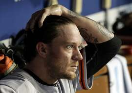 San Francisco Giants starting pitcher Jake Peavy sits in the dugout during the fifth inning of a baseball game against the Los Angeles Dodgers in Los Angeles, Monday, Aug. 31, 2015. (AP Photo/Chris Carlson)