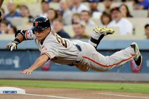 Giants, Dodgers tied after 12 innings - Photo