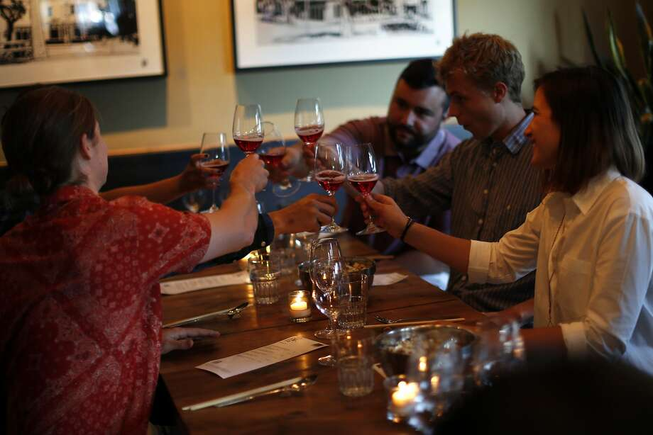 Diners toast glasses of rose as Pink Zebra and Kermit Lynch are hosting an all-rose pop-up dinner at Namu Gaji in San Francisco, Calif., on Monday, Aug. 31, 2015. Photo: Scott Strazzante, The Chronicle