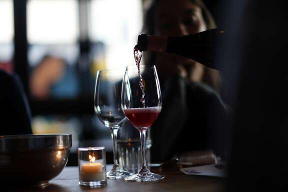 A saint-chinian rose, mas champart, 2014 is poured as Pink Zebra and Kermit Lynch are hosting an all-rose pop-up dinner at Namu Gaji in San Francisco, Calif., on Monday, Aug. 31, 2015.
