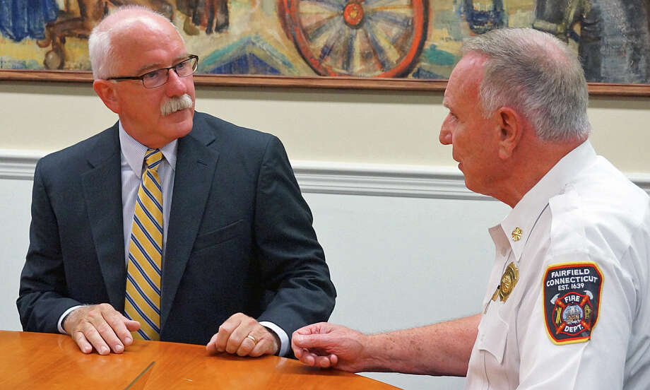Norwalk Fire Chief Denis McCarthy, left, talks with outgoing Fairfield Fire Chief Richard Felner prior to Monday's Fire Commission meeting. McCarthy was hired to take Felner's place and given a five-year contract, with a $142,000 salary. Photo: Genevieve Reilly / Fairfield Citizen / Fairfield Citizen