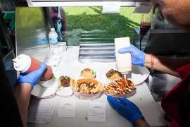 Orders ready to be served in the KoJa Kitchen food truck.