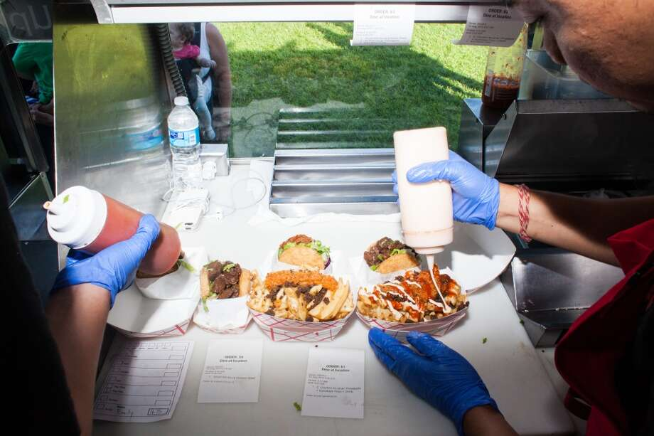 Orders ready to be served in the KoJa Kitchen food truck. Photo: Kelsey McClellan, Special To The Chronicle