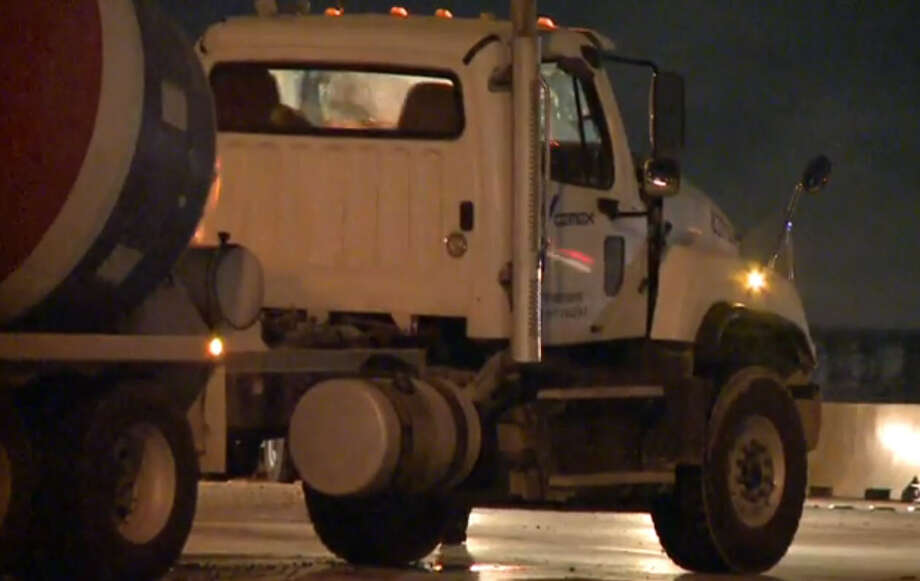 Portions of 610 Loop were shutdown for hours early Tuesday morning after a cement truck overturned, in southwest Houston, spilling its cargo. Photo: Metro Video