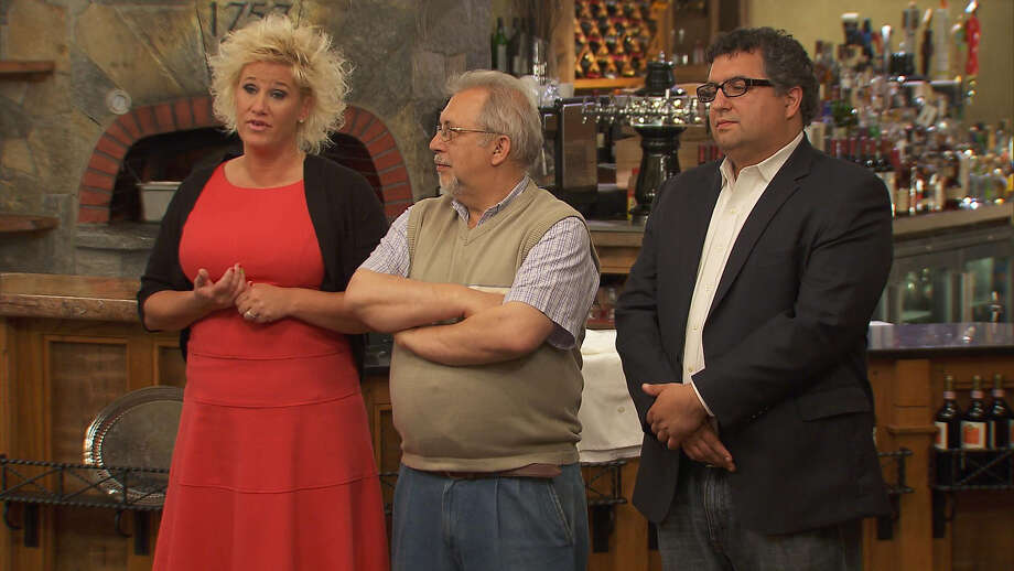 "Pictured: Anne Burrell and Tavern 1757 owners Tony Mavuli and his son, Tonino Mavuli, judge applicants for the position of executive chef  on an upcoming episode of ""Chef Wanted with Anne Burrell."" Photo: Food Network / Contributed Photo / Connecticut Post Contributed"
