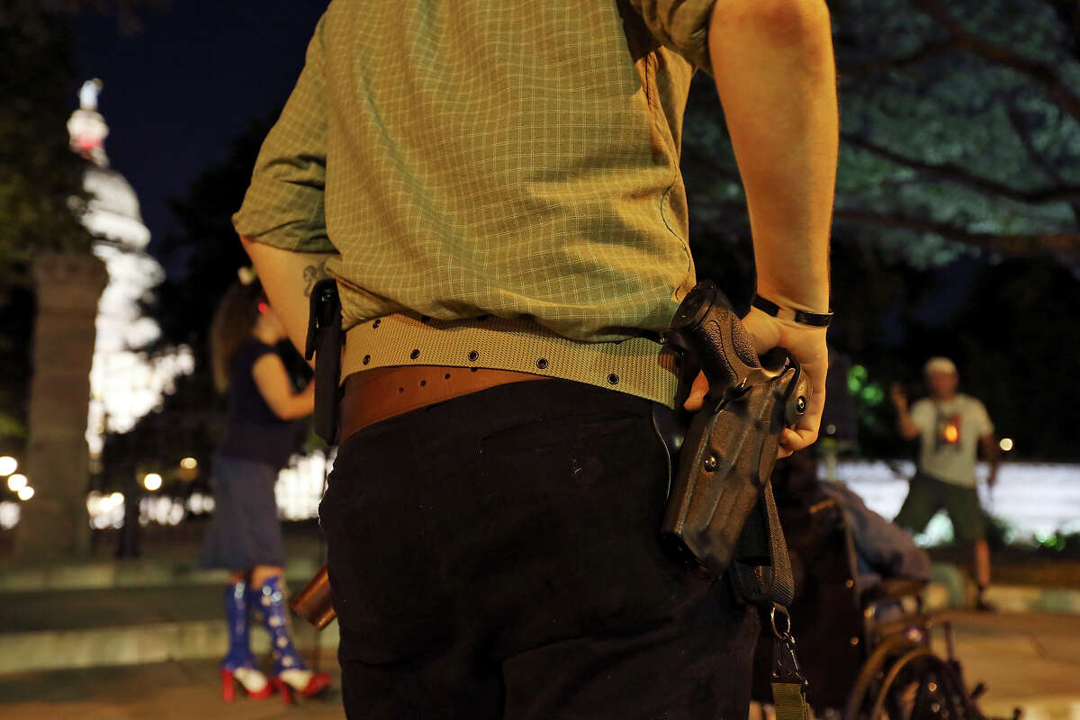 Gun rights activist Pat Cook carries a replica of a Smith & Wesson M&P .40 while attending the first open carry of modern pistols event hosted by DontComply.com and Come and Take It Texas in front of the Texas Capitol in Austin, Tx. Tuesday Sept. 1, 2015. About 30 people attended the event.