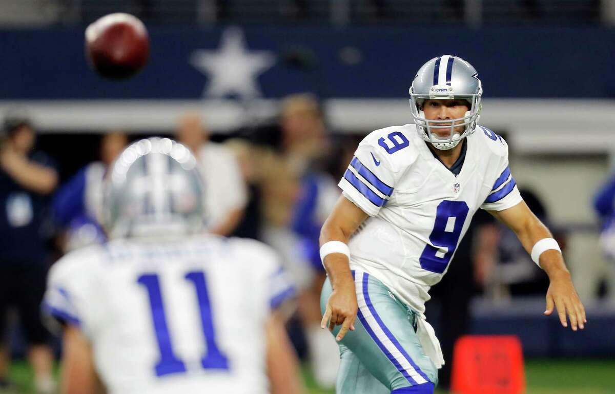 Dallas Cowboys quarterback Tony Romo (9) passes to wide receiver Cole Beasley (11) during the first half of a preseason NFL football game against the Minnesota Vikings Saturday, Aug. 29, 2015, in Arlington, Texas. Minnesota won 28-14.