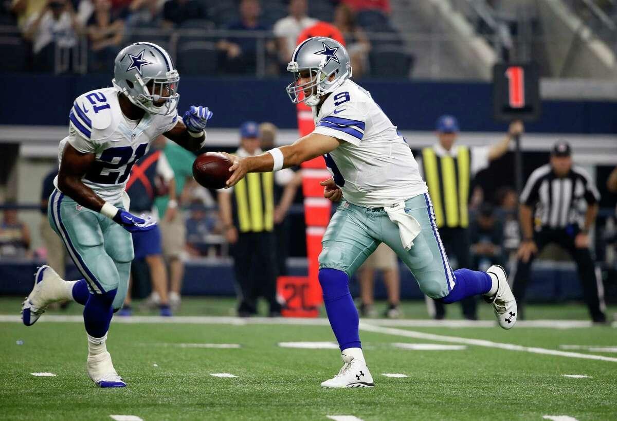 Dallas Cowboys running back Joseph Randle (21) takes the hand off from quarterback Tony Romo (9) during a preseason NFL football game against the Minnesota Vikings Saturday, Aug. 29, 2015, in Arlington, Texas.