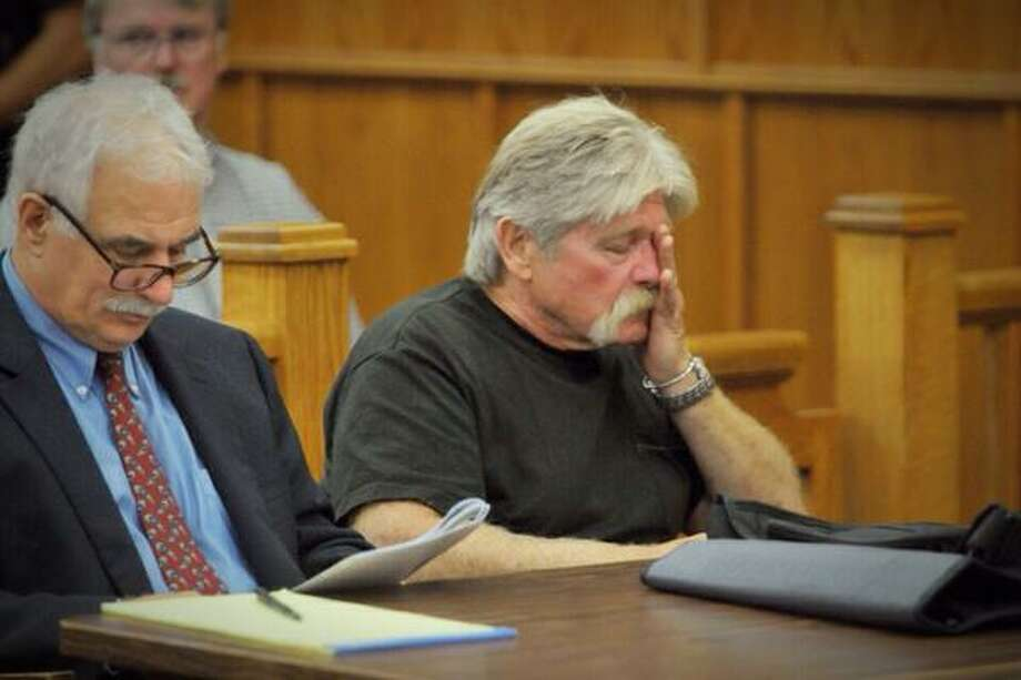 Truck driver Gary Blakley, right, rubs his face at his sentencing for hitting and killing Trooper David Cunniff while Cunniff was doing a traffic stop on the side of the Thruway near Amsterdam. (Paul Buckowski / Times Union)