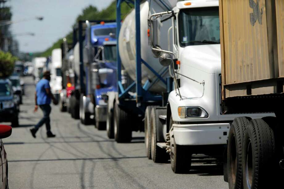 The Consumer Federation of America calculates that consumers pay   more than $1,100 yearly, per household, for the fuel powering freight trucks. Photo: Robert Sciarrino / Associated Press / The Star-Ledger