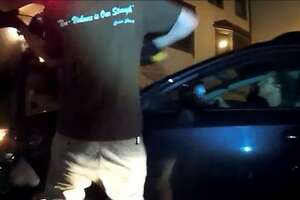 Critical mass ride wears ironic shirt while smashing car - Photo
