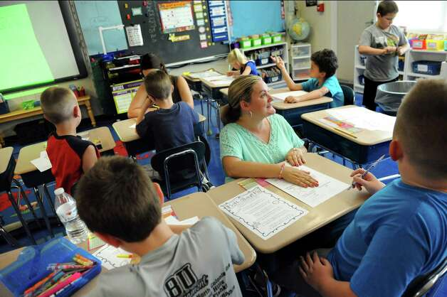 Teacher Shayna Usher helps her third-graders with a math activity on the first day of school on Tuesday, Sept. 1, 2015, at Glencliff Elementary in Rexford , N.Y. (Cindy Schultz / Times Union) Photo: Cindy Schultz / 00033180A
