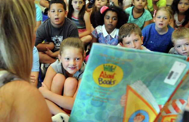 Chloe Comley, 7, center, joins fellow second-graders as they listen to teacher Nicole Connally read a story on the first day of school on Tuesday, Sept. 1, 2015, at Glencliff Elementary in Rexford , N.Y. (Cindy Schultz / Times Union) Photo: Cindy Schultz / 00033180A