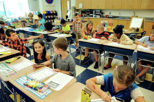 Teacher Nicole Connally, back center, works with her second-graders on the first day of school on Tuesday, Sept. 1, 2015, at Glencliff Elementary in Rexford , N.Y. (Cindy Schultz / Times Union) Photo: Cindy Schultz / 00033180A