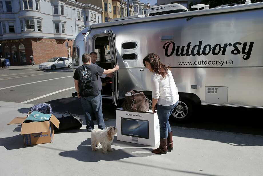 Outdoorsy staff members bring their belongings down to the waiting Airstream Monday August 31, 2015. Jeff Cavins and Jen Young, the couple who started Outdoorsy, an Airbnb for RV's and trailers, moved furniture from their North Beach apartment to their Airstream trailer to begin living the RV lifestyle. Photo: Brant Ward, The Chronicle