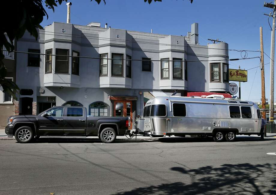 The staff of Outdoorsy managed to find a large parking space near their apartment for the Airstream and large truck Monday August 31, 2015. Jeff Cavins and Jen Young, the couple who started Outdoorsy, an Airbnb for RV's and trailers, moved furniture from their North Beach apartment to their Airstream trailer to begin living the RV lifestyle. Photo: Brant Ward, The Chronicle
