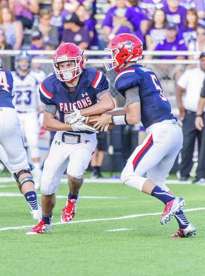 Clear Lake's Cody Turner, left, receives the ball from quarterback Will Smith during Clear Lake's opening weekend loss to Port Neches-Groves last week. Photo: ÂKim Christensen, Photographer / ©Kim Christensen