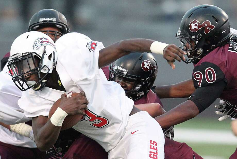 Dawson running back Saevion Johnso, left, and Pearland running back Davier Pinkston, right, showcase the offensive firepower that will be on display when Dawson and Pearland square off at The Rig Friday night. Photo: Thomas B. Shea, Freelance / © 2014 Thomas B. Shea