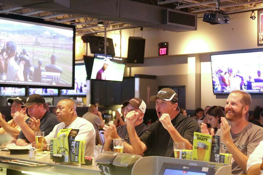 Supporters react to the action in progress as Pearland competes in the Little League World Series last week during one of the community's watch parties at Buffalo Wild Wings in Pearland. Photo: Pin Lim, Freelance / Copyright Forest Photography, 2015.