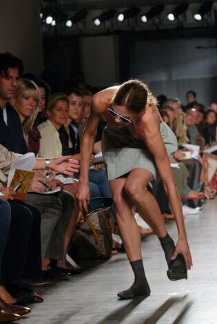 NEW YORK - SEPTEMBER 11:  A model falls on the runway at the Proenza Schouler Spring 2007 fashion show during Olympus Fashion Week at Milk Gallery September 11, 2006 in New York City.  (Photo by Brad Barket/Getty Images) Photo: Brad Barket, Getty Images / 2006 Getty Images