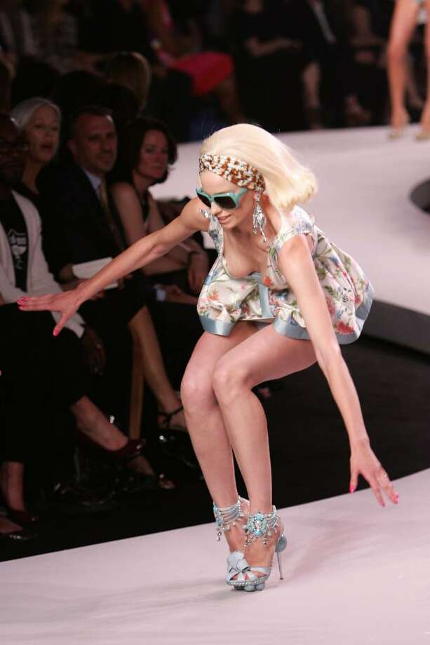 NEW YORK - MAY 14:  A model stumbles while walking the runway at the Dior 2008 Cruise Collection fashion show on May 14, 2007 in New York City.  (Photo by Bryan Bedder/Getty Images) Photo: Bryan Bedder, Getty Images / 2007 Getty Images