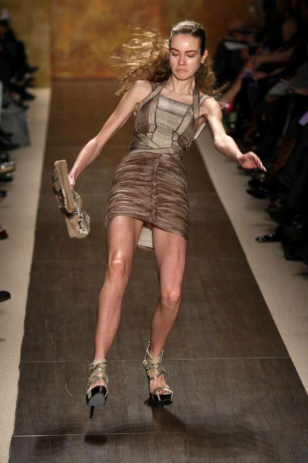 NEW YORK - FEBRUARY 15:  A model falls as she walks the runway at the Herve Leger Fall 2009 fashion show during Mercedes-Benz Fashion Week in the Promenade at Bryant Park on February 15, 2009 in New York City.  (Photo by Scott Gries/Getty Images for IMG) Photo: Scott Gries, Getty Images For IMG / 2009 Getty Images