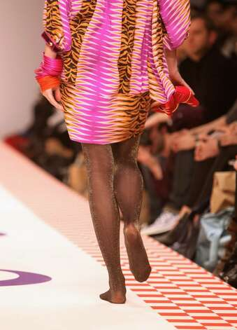 LONDON - FEBRUARY 22:  A model loses her shoes as she walks down the catwalk during the Eley Kishimoto show, as part of London Fashion Week a/w 2009 at the BFC Tent, Natural History Museum on February 22, 2009 in London, England.  (Photo by Tim Whitby/Getty Images) Photo: Tim Whitby, Getty Images / 2009 Getty Images