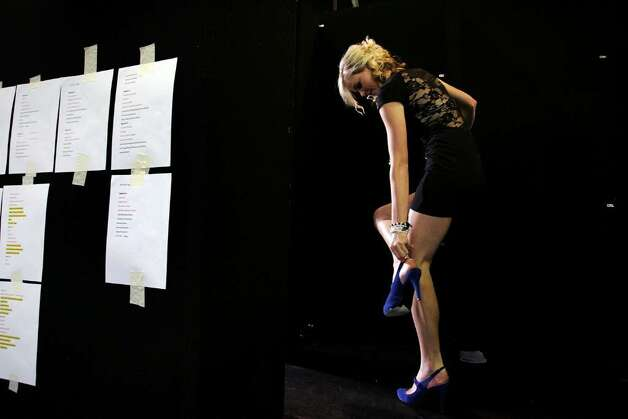 SYDNEY, AUSTRALIA - JUNE 27:  A young model adjusts her shoe backstage during the School Formal Expo at Fox Studios on June 27, 2009 in Sydney, Australia. The high school formal industry is becoming big business in Australia with teens spending hundreds of dollars on hair and make-up, limousines, photographers, florists, jewellery and designer dresses. The school formal industry is worth AUD170 million annually in New South Wales alone.  (Photo by Lisa Maree Williams/Getty Images) Photo: Lisa Maree Williams, Getty Images / 2009 Getty Images