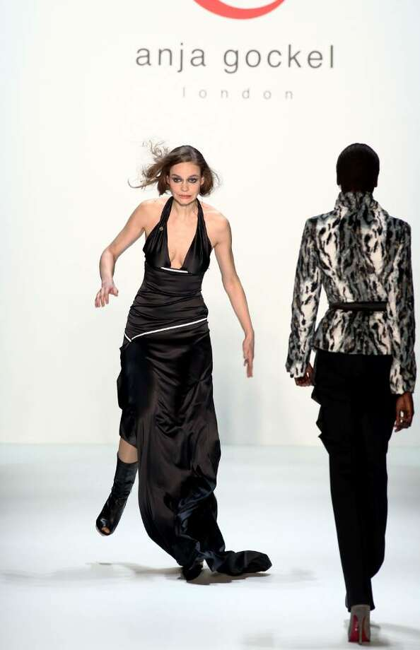BERLIN - JANUARY 21:  A model stumbles on the runway at the Anja Gockel Fashion Show during the Mercedes-Benz Fashion Week Berlin Autumn/Winter 2010 at the Bebelplatz on January 21, 2010 in Berlin, Germany.  (Photo by Andreas Rentz/Getty Images) Photo: Andreas Rentz, Getty Images / 2010 Getty Images