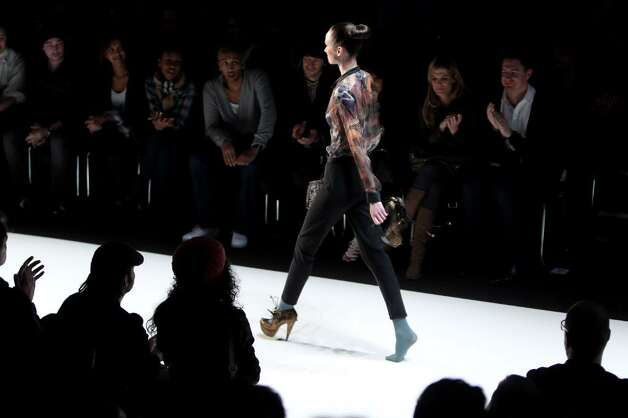 BERLIN - JANUARY 22:  A model walks the runway with a shoe in her hand at the Marcel Ostertag Fashion Show during the Mercedes-Benz Fashion Week Berlin Autumn/Winter 2010 at the Bebelplatz on January 22, 2010 in Berlin, Germany.  (Photo by Sean Gallup/Getty Images) Photo: Sean Gallup, Getty Images / 2010 Getty Images