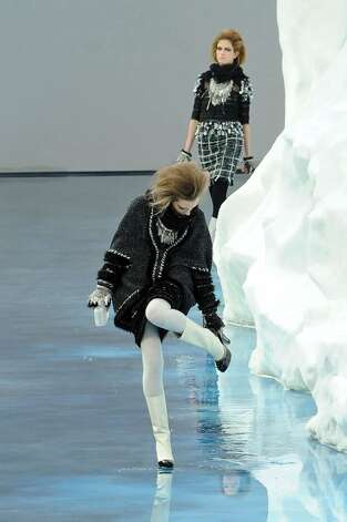 PARIS - MARCH 09:  Models walk the runway at the Chanel Ready to Wear show as part of the Paris Womenswear Fashion Week Fall/Winter 2011 at Grand Palais on March 9, 2010 in Paris, France.  (Photo by Francois Durand/Getty Images) Photo: Francois Durand, Getty Images / 2010 Getty Images
