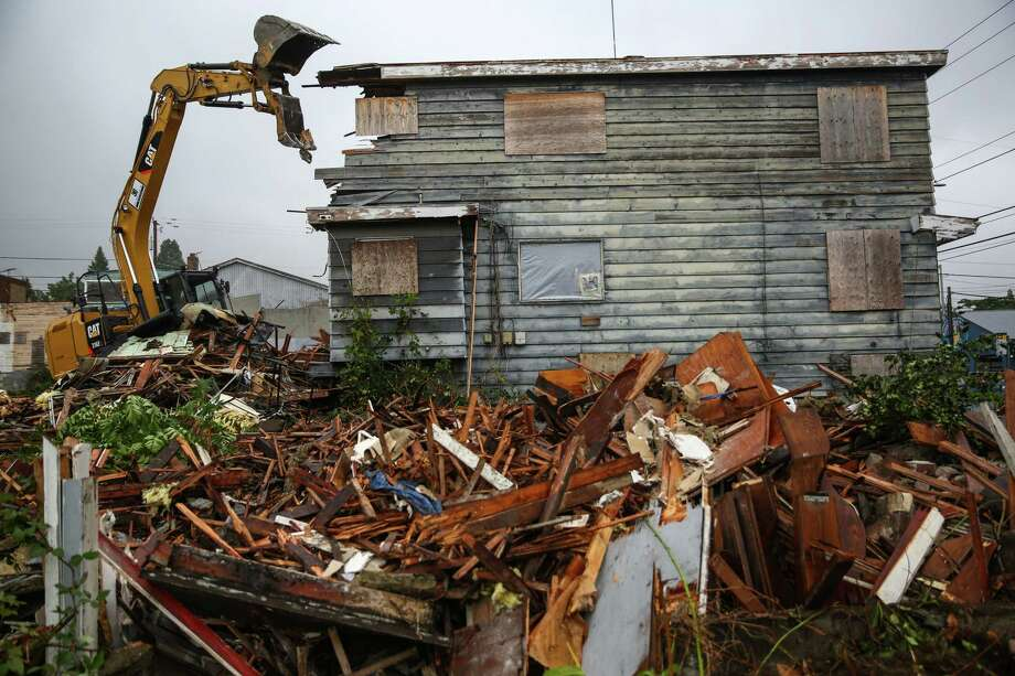 Blighted properties formerly owned by Hugh and Martha Sisley are torn down Tuesday, September 1, 2015 in the Roosevelt neighborhood. Developers and the city intend to turn the properties into affordable housing and public spaces. Photo: JOSHUA TRUJILLO, SEATTLEPI.COM / SEATTLEPI.COM