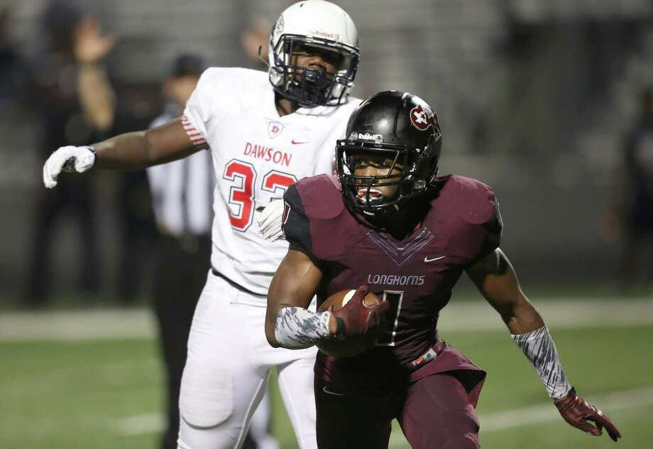 Running back Darius Anderson (1) of George Ranch rushes for touchdown pass defensive end Dominique Taylor (33) of the Dawson Eagles in the 4th quarter on Friday, August 28, 2015 at Traylor Stadium in Rosenberg, TX  (Photo: Thomas B. Shea/For the Chronicle) Photo: Thomas B. Shea, Freelance / © 2014 Thomas B. Shea