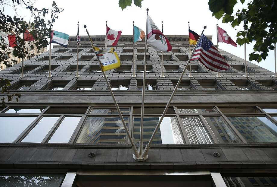 Flags fly above the Market Street entrance to the Chancery Building in San Francisco, Calif. on Tuesday, Sept. 1, 2015. Photo: Paul Chinn, The Chronicle