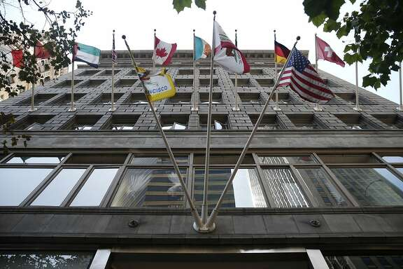 Flags fly above the Market Street entrance to the Chancery Building in San Francisco, Calif. on Tuesday, Sept. 1, 2015.