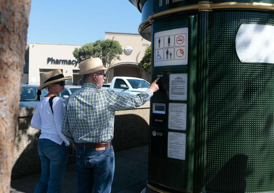 From left, Joan Priestley and Joe McAleavey look at the JC Decaux toilet at Market Street near Church on Tuesday, Sept. 1, 2015 in San Francisco, Calif. San Francisco Public Works' Pit Stop program hopes to make the toilets more attractive to the public by making sure they aren't used for drug dealing and other illicit activities. Photo: Nathaniel Y. Downes, The Chronicle