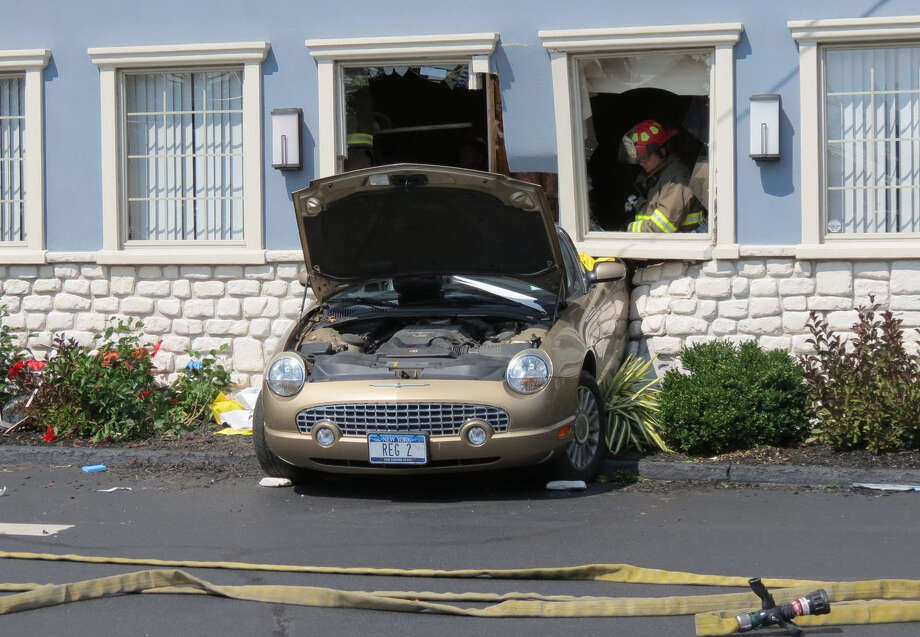 A car crashed into the Blue Ribbon Diner on State Street injuring several diners Tuesday, Sept. 1, 2015, in Schenectady, N.Y. Four people were sent to the hospital when the driver of a car mistakenly backed into the side of the restaurant. (Tom Heffernan Sr. / Special to the Times Union) Photo: Tom Heffernan Sr.