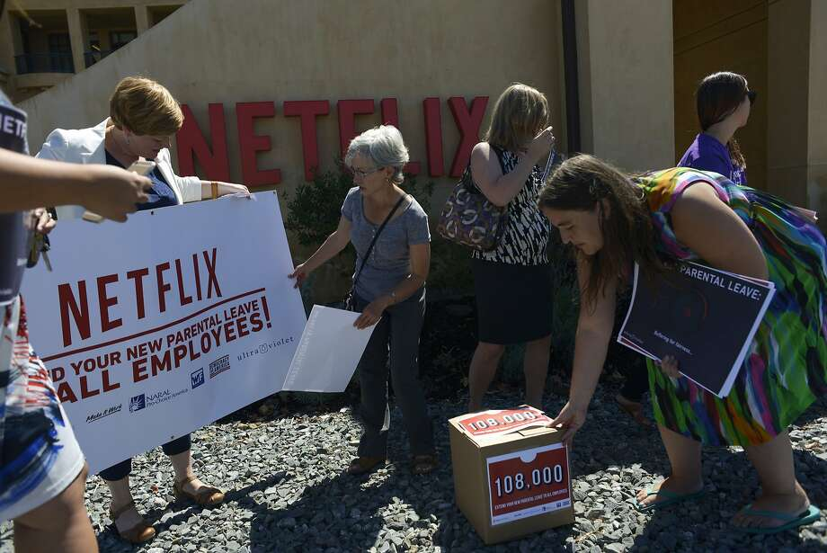 A broad coalition of activists gather in front of Netflix to protest the company's parental leave program in Los Gatos, Calif., on Tuesday, Sept. 1, 2015. Photo: Brandon Chew, Special To The Chronicle