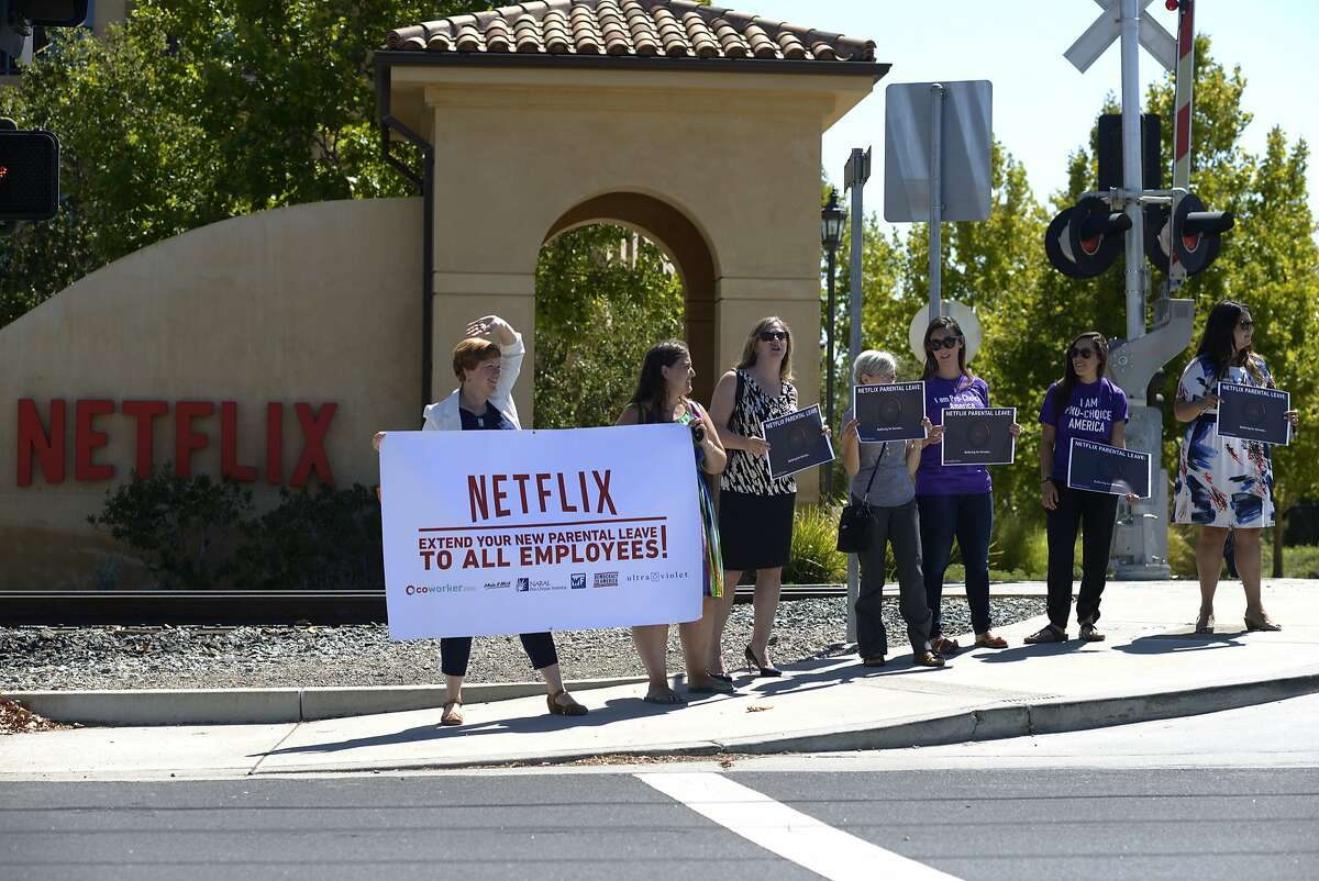 Activists gather in front of Netflix to protest the company's parental leave program in Los Gatos in September 2015.