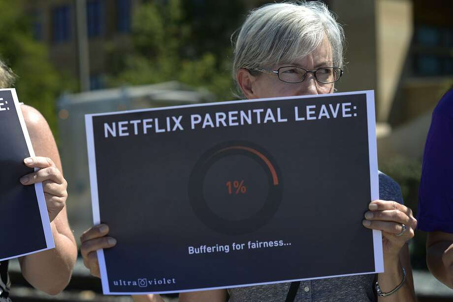 Martha Schumacher, 57 and Sunnyvale resident, holds a sign at Netflix to protest the company's parental leave program in Los Gatos, Calif., on Tuesday, Sept. 1, 2015. Photo: Brandon Chew, Special To The Chronicle
