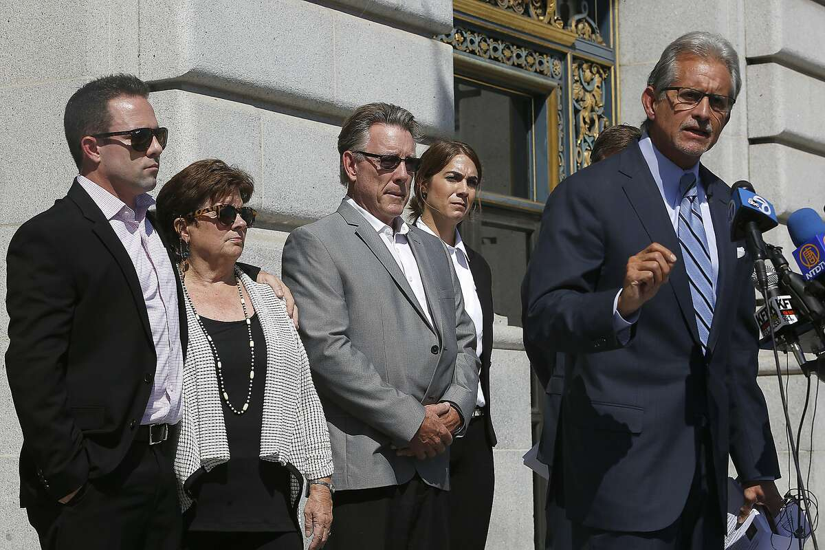 Brother Brad Steinle (left), Liz Sullivan (second from left) and Jim Steinle (middle), parents of Kathryn Steinle, watch as attorney Frank Pitre (far right) announce filing claims holding sheriff Ross Mirkarimi and immigration and customs enforcement responsible for their daughter's death at city hall in San Francisco, Calif., on Tuesday, September 1, 2015.