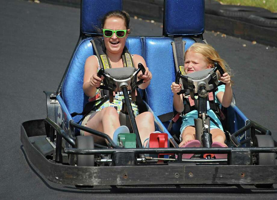 Corinne Cassavaugh of East Nassau has fun driving a race car with her cousin Grace Pelletier, 6, of Stephentown at FunPlex Fun Park in East Greenbush, N.Y.,  on Tuesday, Sept. 1, 2015. (Lori Van Buren / Times Union) Photo: Lori Van Buren