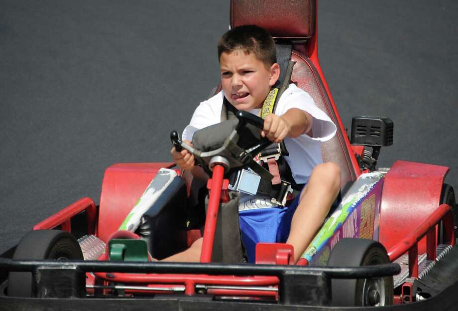 Derek DeSango, 9, of Rensselaer has fun driving a race car at FunPlex Fun Park in East Greenbush, N.Y., on Tuesday, Sept. 1, 2015. (Lori Van Buren / Times Union) Photo: Lori Van Buren
