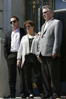 Brother Brad Steinle (left) with Liz Sullivan (middle) and Jim Steinle (right) parents of Kathryn Steinle, announce filing claims holding sheriff Ross Mirkarimi, immigration and customs enforcement, and the bureau of land management responsible for their daughter's death at city hall in San Francisco, Calif., on Tuesday, September 1, 2015.