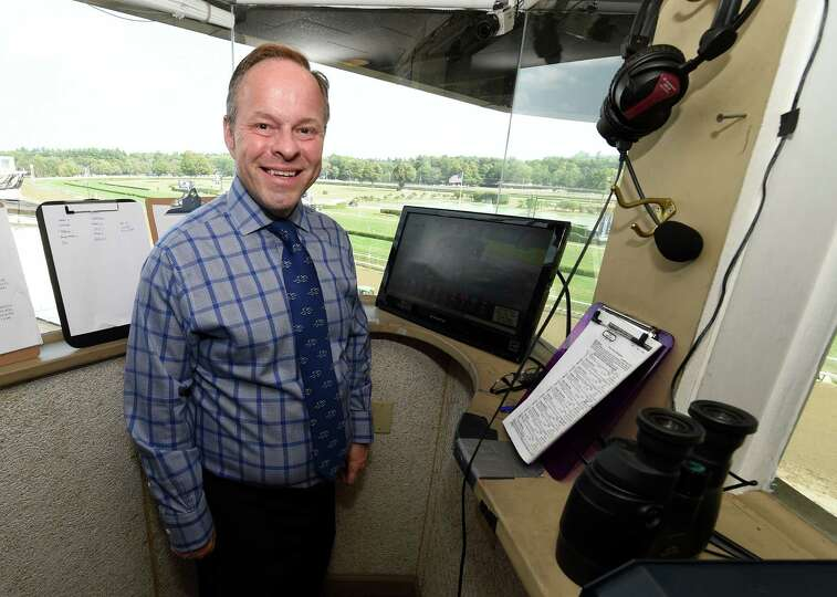 Track announcer Larry Collmus in his office  Monday afternoon Aug. 31, 2015 at the Saratoga Race Cou