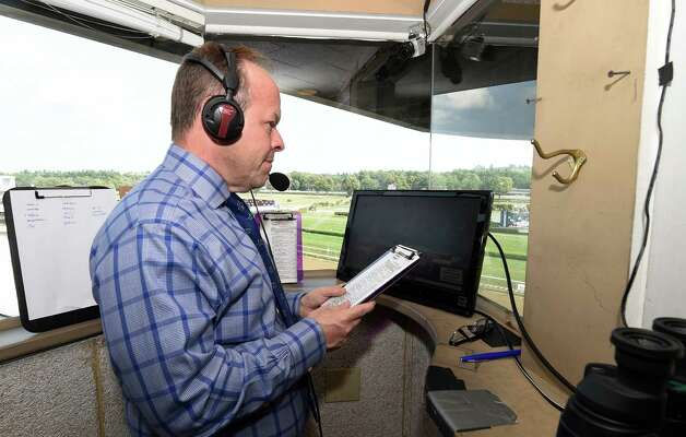 Track announcer Larry Collmus in his office  Monday afternoon Aug. 31, 2015 at the Saratoga Race Course in Saratoga Springs, N.Y.    (Skip Dickstein/Times Union) Photo: SKIP DICKSTEIN