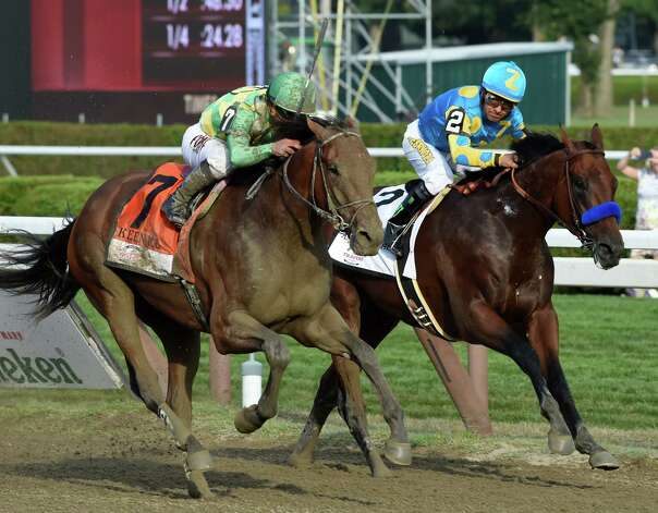 #7 Keen Ice with jockey Javier Castellano, overtakes American Pharoah with jockey Victor Espinoza to win the 146th running of the Travers Stakes Saturday evening Aug. 29, 2015 at the Saratoga Race Course in Saratoga Springs, N.Y.    (Skip Dickstein/Times Union) Photo: SKIP DICKSTEIN / 00033110A